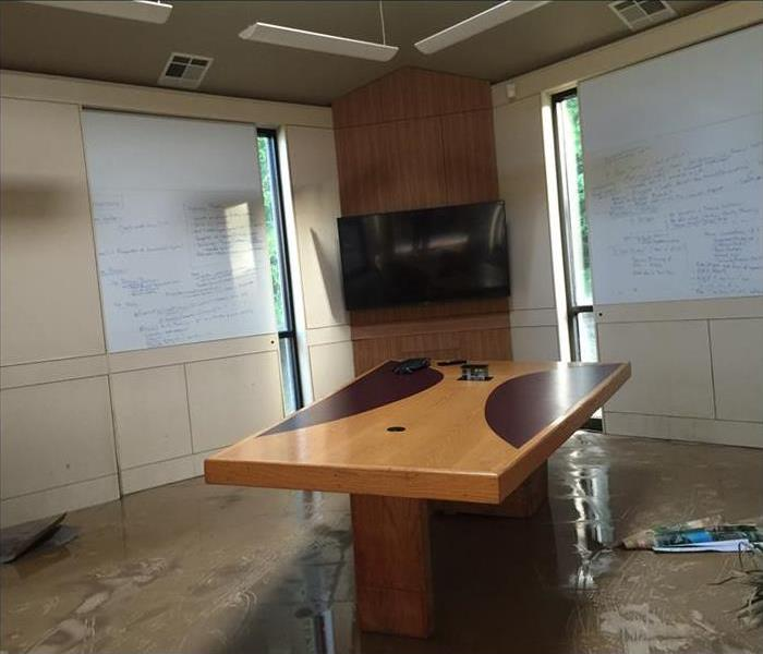 office conference room flooded after storm