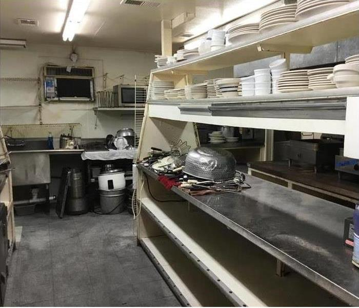 commercial kitchen after fire damage has been cleaned up
