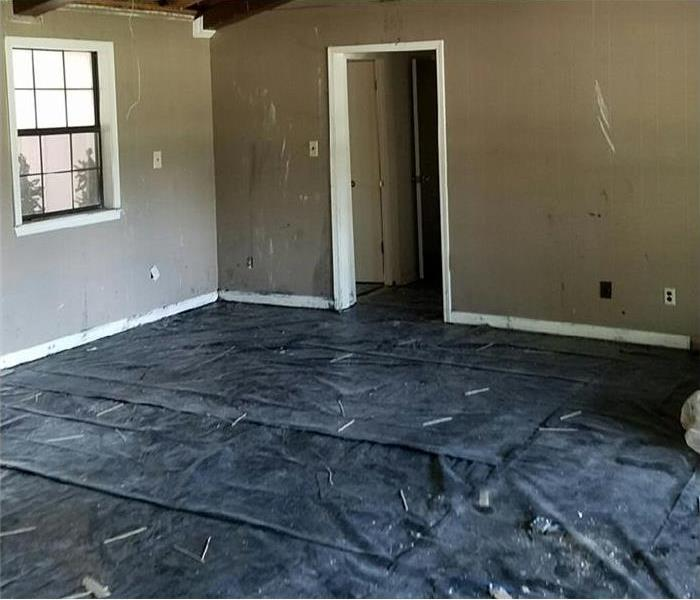 interior of home with damaged floors removed ready for new floor install after fire and water damage