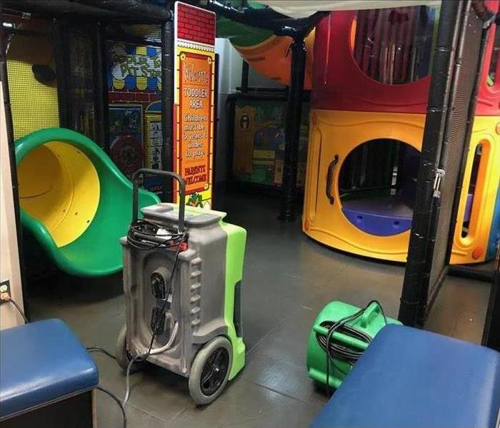 indoor playscape with drying equipment after water damage