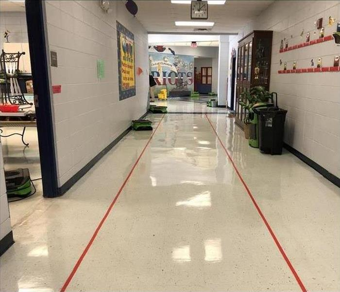green drying equipment in elementary school hallway