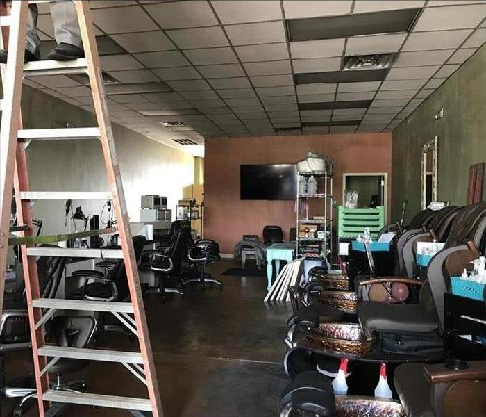 a nail salon is covered by smoke and fire damage