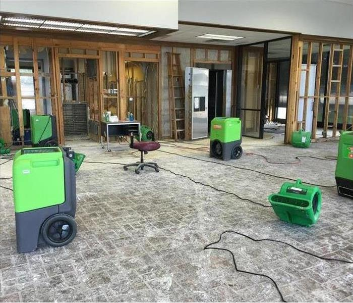 green drying equipment in the lobby of a bank after a flood